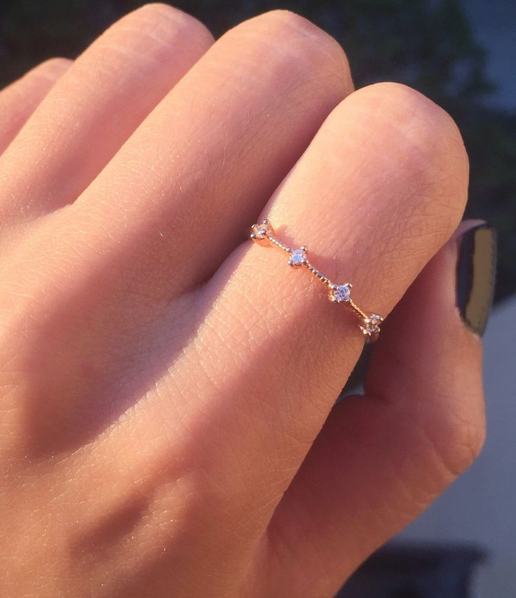 Rose Gold Four Stone Band - dainty rose gold ring / minimal ring / thin band ring / simple band / stacking ring / gifts for her / birthday by masfemme on Etsy https://www.etsy.com/listing/235059374/rose-gold-four-stone-band-dainty-rose