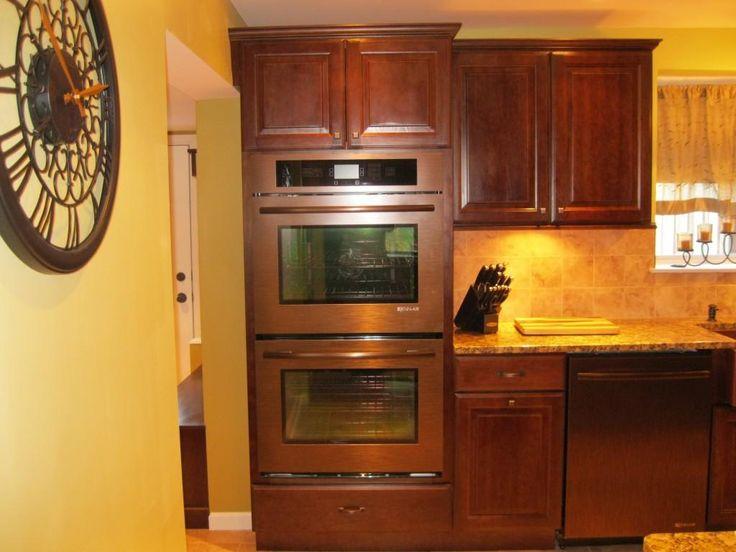 Copper Colored Kitchen Appliances Under Small Cabinet And Marble Countertop Also Round Clock In Minimalist Design