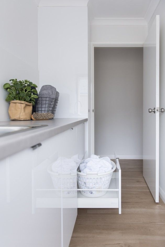 Hide the hamper in your laundry room by placing it in a drawer. Great organizing idea and keeps the laundry room clean