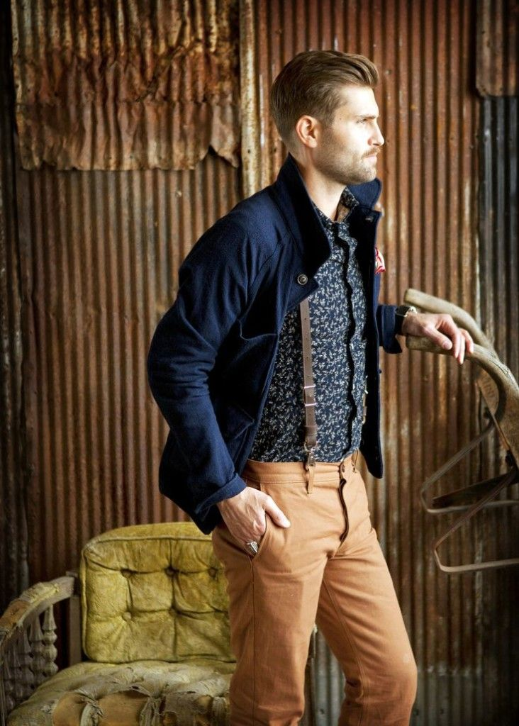 A nice, trendy, country style look. Light colored pants, printed dress shirt, belt suspenders, and a nice blue jacket.