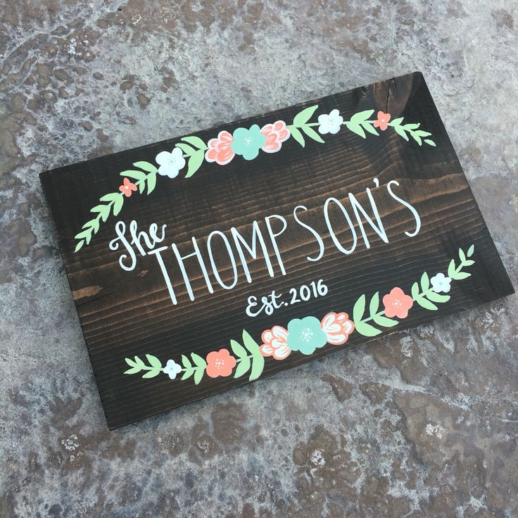 "Custom Family Name Sign With Established Date and Flowers. Wedding. Engagement. Handmade hand-painted custom wooden signs for your home and more made by The Rustic Violet. Order at https://www.etsy.com/shop/TheRusticViolet and follow me on Instagram under ""TheRusticViolet"""