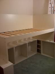 how to build a loft bed with storage: we had a safety bed rail lying around that we were no longer using so i used it to make the side wall for the loft