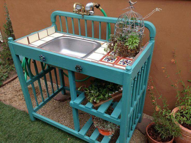 I love this! Using an old fashioned baby change table for an outdoor sink and potting bench!