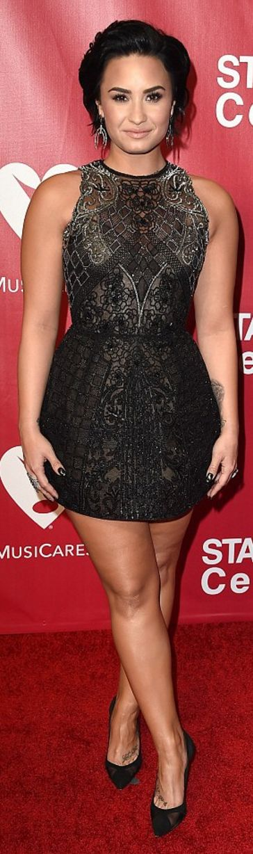 Who made Demi Lovato's black dress and mesh pumps?