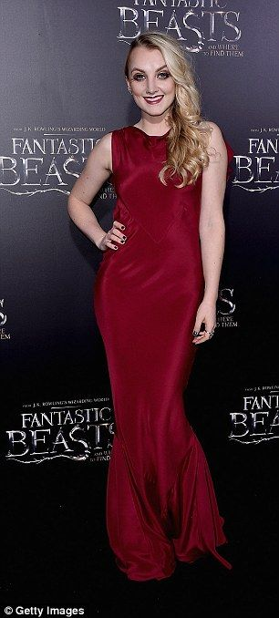 Red hot! Harry Potter actress Evanna Lynch, 25, smouldered in a figure-hugging deep burgun...