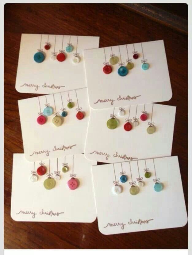 xmas cards w. hanging button ornaments. -- could be done w. polymer clay for flowers or something else