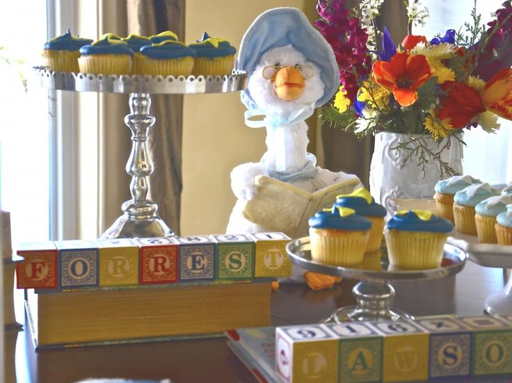 Book stands, nursery rhyme cupcakes, and an adorable Mother Goose for the decor.
