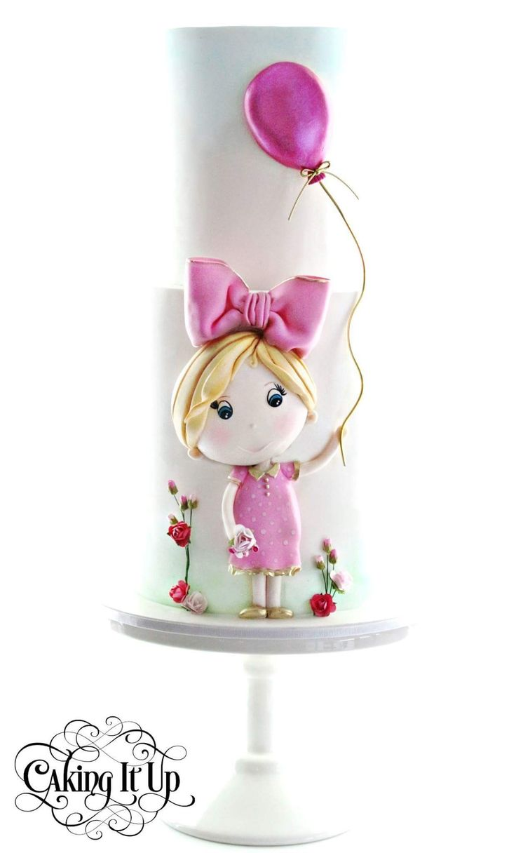 Cute girl in pink cake