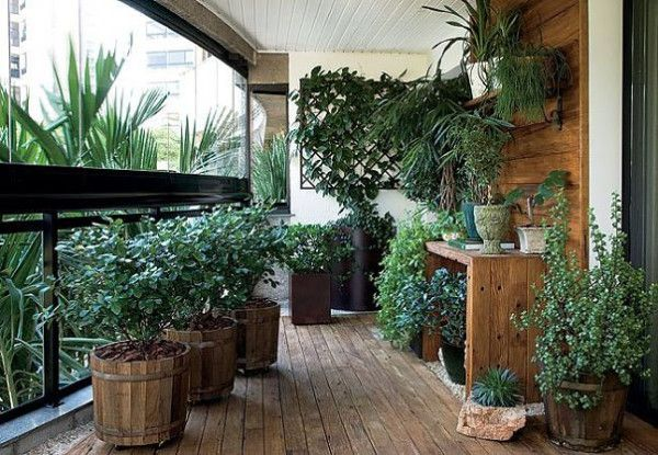 Plants on a balcony with wooden details
