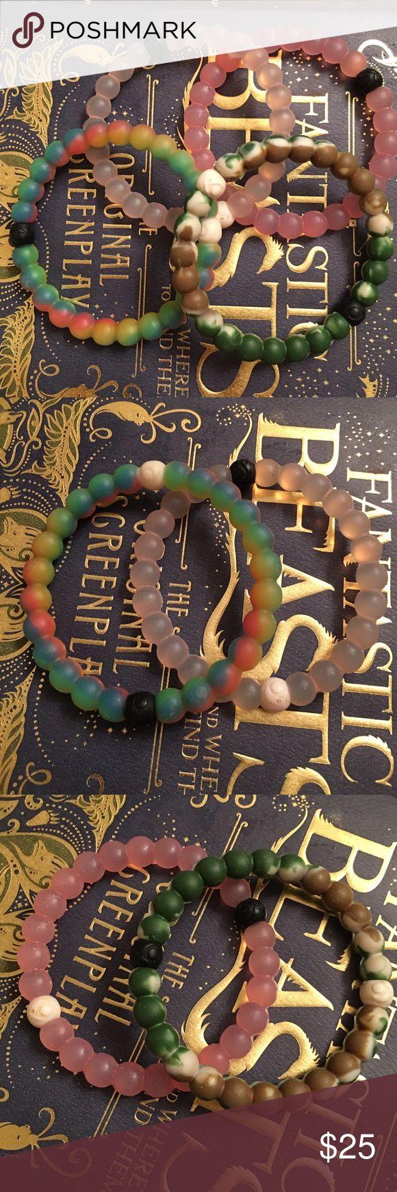 Lokai Bracelets Three worn Lokai bracelets. Good condition clear, pink and camouflage. Size Medium Lokai Jewelry Bracelets