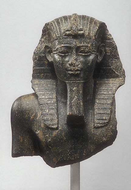 Bust from Statue of a King - Period: Late Period, Saite. Dynasty: Dynasty 26. Reign: reign of Psamtik I. Date: 664–610 B.C. Geography: From Egypt. Medium: Granite.