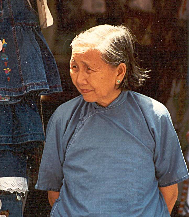 Woman in flea market, Hong Kong (1996)