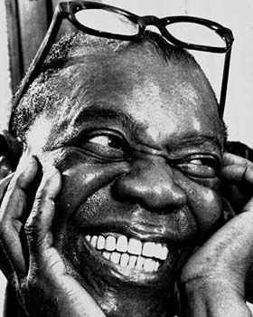 Louis Armstrong laughing