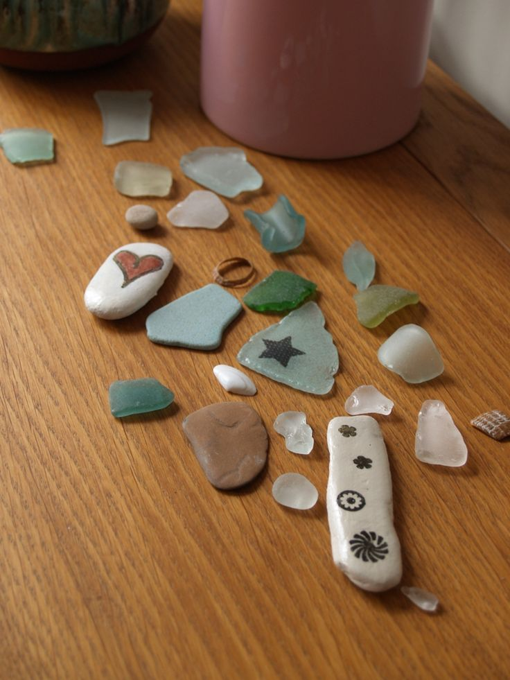 Stamping on pebbles and sea glass.