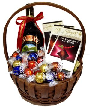 This basket contains 1 bottle of baileys and approx. 500 grams of Lindt chocolate. - Lindt Cranberry - Lindt Orange - Lindt dark 70% cocoa - Lindor fine chocolate  This arrangement can be a great gift for valentine, Christmas, birthday or other celebrations. $78.00