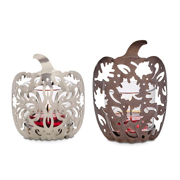 "Leaves & Pumpkins Votive Pair. Sure signs of the season—autumn pumpkins and falling leaves—cleverly combined in a duo of pierced metal holders. One matte bronzetone finish:  4¼""h. One shiny silvertone finish: 3½""h. Includes two glass votive cups to hold votives or tealights, sold separately.  Item #:  P92503"