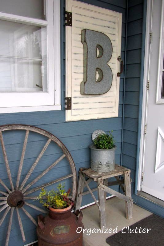 I have two shutters that this might work! Outdoor Junk Vignette & Cabinet Door Decor Project Tutorial www.organizedclutterqueen.blogspot.com