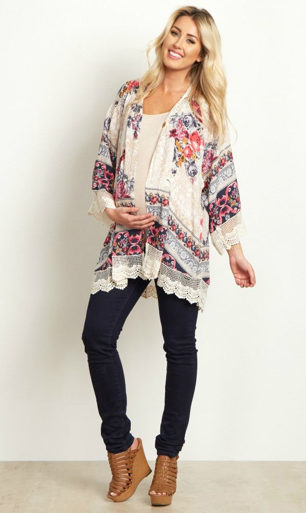 A gorgeous floral maternity kimono is the perfect way to kick off a new wardrobe this year. A pretty floral pattern meets lace accents on the sleeves and hemline for the ultimate feminine essential. Layer this maternity kimono over a basic maternity top and pair with maternity jeans and boots for a perfect ensemble.