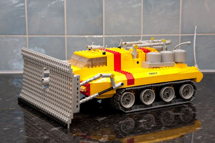 "https://flic.kr/p/9EibKF | Lego Technic Firefly MOC - Front View I | This is a model of the ""Thunderbirds"" international rescue vehicle ""Firefly"", which is delivered to rescue situations in the pod of Thunderbird 2. I built this MOC using the new Lego Technic large sized caterpillar treads. The front windscreen is made from tranlucent sloping blocks from about 1970! The bulldozer blade moves up and down and tilts, and the cntral canon can move inwards and outwards through..."