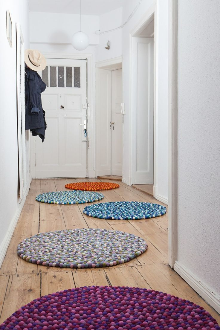 Felt-ball-rug Viola in round invites you to relax with deep purple and warm pink tones. The perfect partner to leave behind the daily routine and escape to the dream world.   myfelt carpets are made out of 100% pure, sheared wool. The raw materials – the
