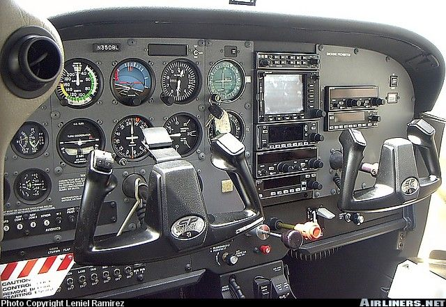 Cessna 172 instrument panel - this is a newer-model C172SP, it looks like. I actually flew to Independence, KS to pick up a plane like this from the factor and fly it back to Troy, MI while I was in college. Fun!