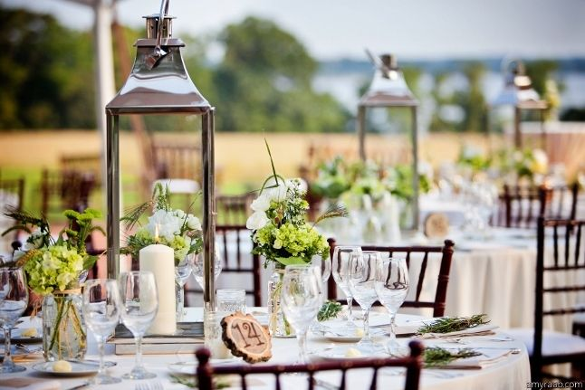 Tall Lanterns And Wood Table Numbers For Outdoor Wedding Reception