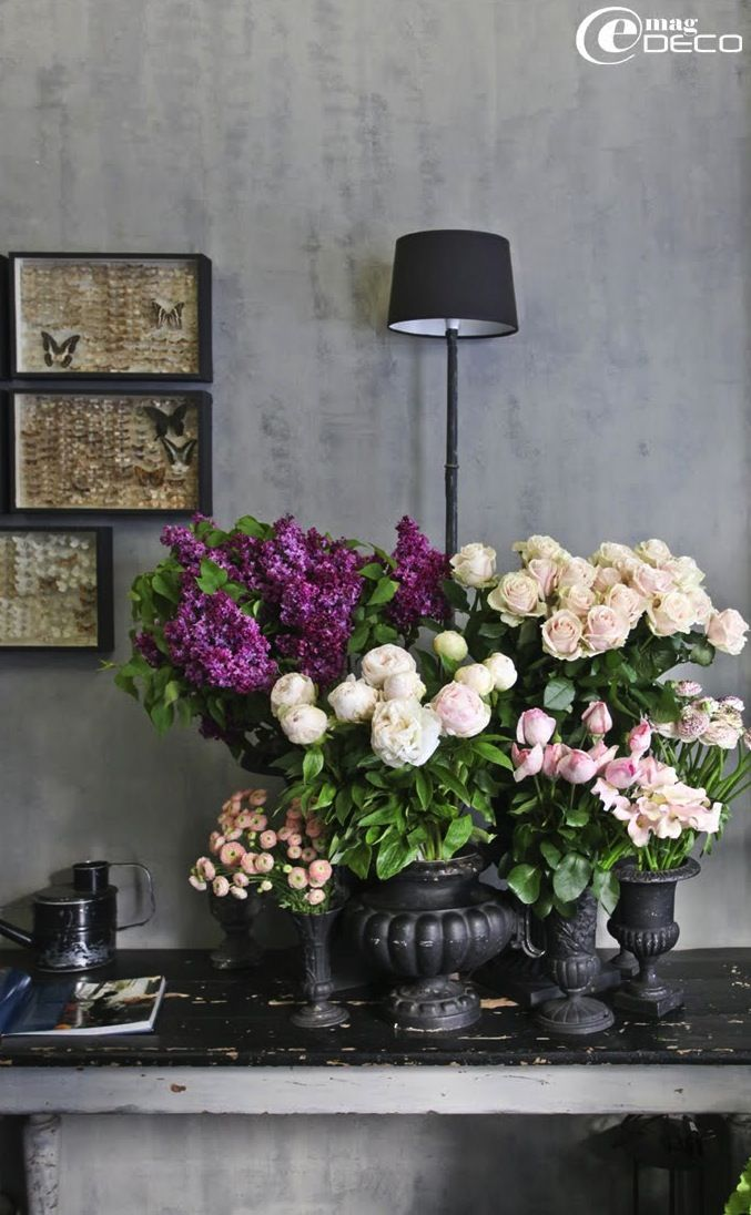 Love the pop of purple and mix of flowers. Do not like the vases