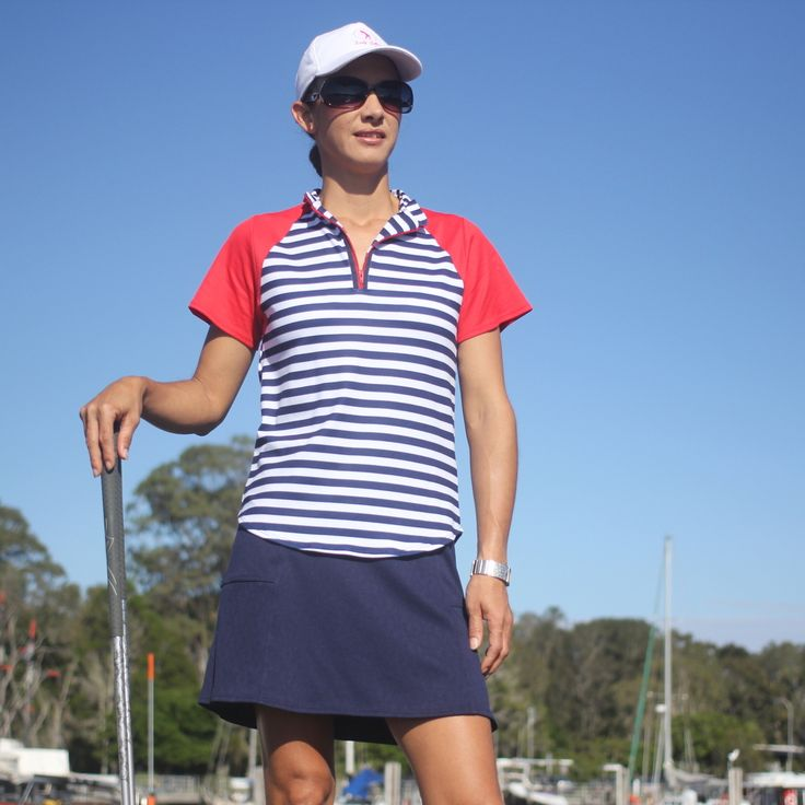 (http://www.ladygolfwear.com.au/ladies-golf-outfit-striped-top-with-red-navy-skort/)