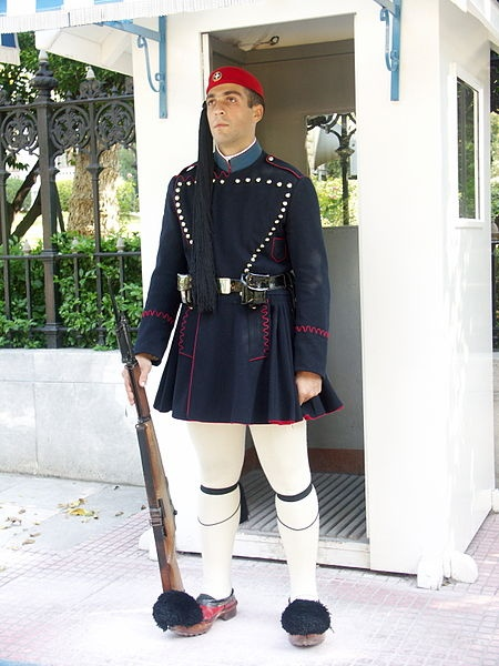 Greek Evzone - guard of honour at the Tomb of the Unknown Soldier, Syntagma Square, Greece, wearing traditional foustanella uniform of Macedonian.