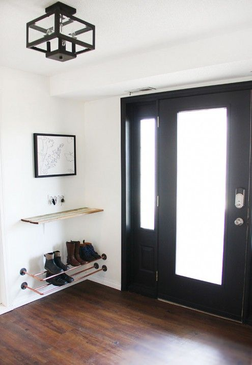Foyer makeover -- before and after, with black painted door, floating landing strip, and copper shoe rack.