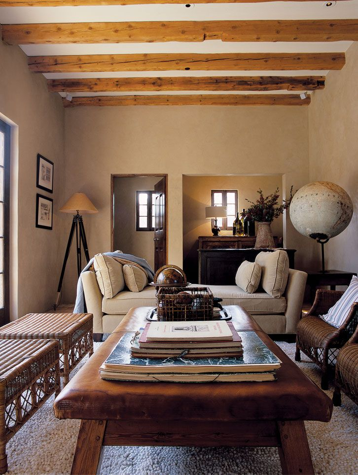 great masculine feel to this room ... love the globes + daybed + beams + wicker