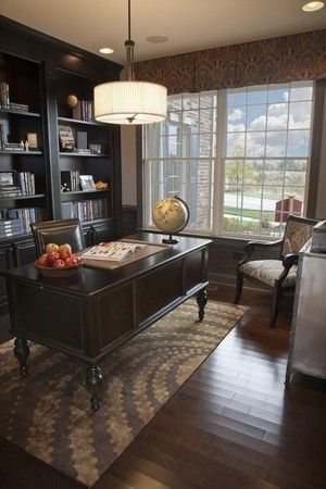 Traditional home office, Built-in storage, Chandelier, Coffered ceiling, Dark woods, desk, Upholstered armchair, Window treatments, Wood ceiling & floor