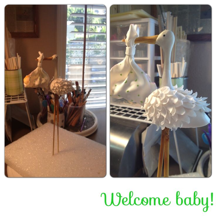Gumpaste Baby stork cake topper. Cake to come!! Check Amber Adamson out on Facebook - Top Tier Cakes for All Occasions !!!  8-26-13