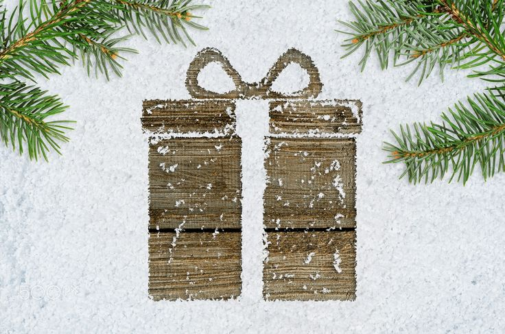 gift box on snow - christmas card or new year background made of gift box handwritten on snow and fir-tree branches over wooden table