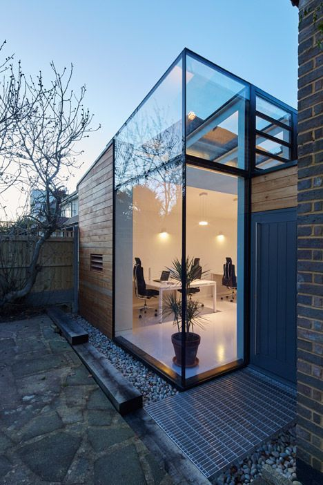 Timber and glass office extension on the side of a mid-century home.