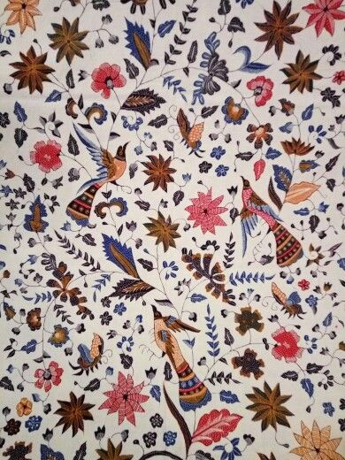 Batik cirebon with bird and flower design with white base color and meticulous hand work.