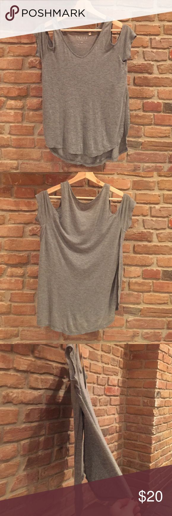 Guess Exposed Shoulder Shirt 🌞 Pretty grey Guess shirt with exposed shoulders and side slits ~ fits loosely ~ can dress it up for going out or wear it casually 🌞 Guess Tops Tees - Short Sleeve