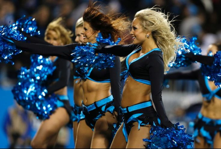 Carolina Panthers cheerleaders perform during the first half of an NFL football game against the New England Patriots in Charlotte, N.C., Monday, Nov. 18, 2013.