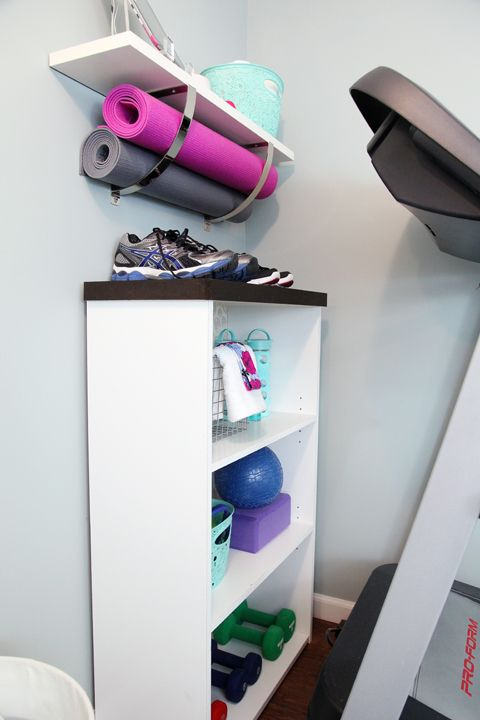 Great idea for using a cheap white bookshelf and upper floating shelf for exercise gear.