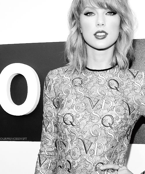 She always looks so pretty in black and white photos! I'm still wondering what the letters mean!