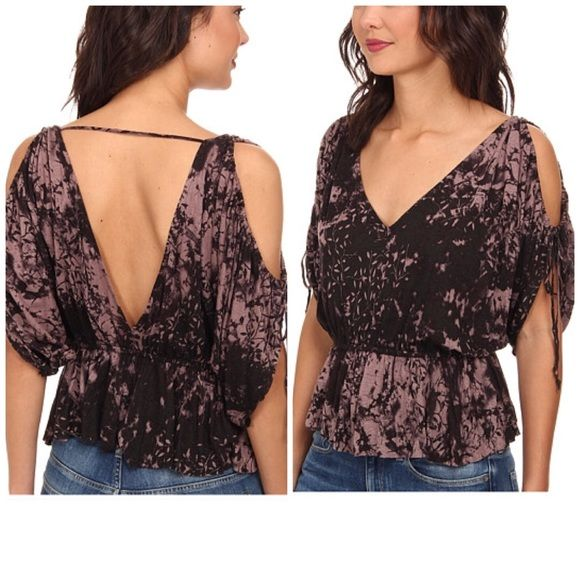 Free People Abracadabra Top Boho-flow and open-shoulder silhouette highlight this peplum top. Deep V-neck and open back. Batwing sleeves feature a drawstring self-tie detail and shoulder cut-outs. Elastic waist for a custom fit. Peplum, skirted hem. 70% rayon, 30% linen. Machine wash cold, lay flat to dry. Imported. Dodge-and-burn floral print throughout. Free People Tops