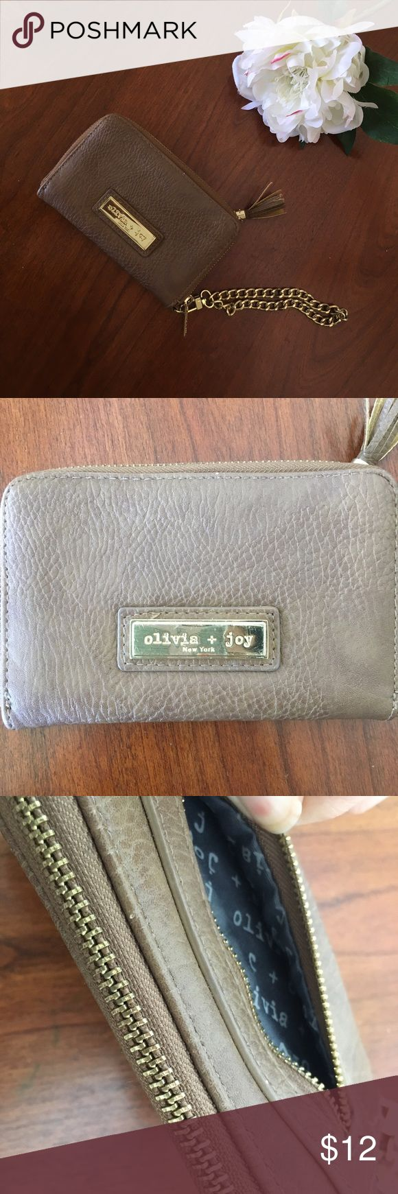 Olivia + Joy zipper wallet wristlet brown gold Adorable Olivia + Joy wallet convertible to a wristlet. 5 card slots, two smaller zipper pouches, a large slot on the side sand full zip around. I liked it because my phone fit inside the main pocket. Approx measurements in photos. Gold tone wrist strap has some minor wear on the finish. Name plate has minor scratching. Smoke free dog friendly home. Olivia + Joy Bags Wallets