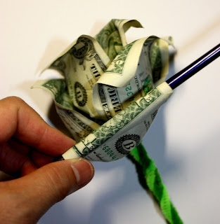 3 bills per rose, in any denomination  Floral wire  Floral tape (optional