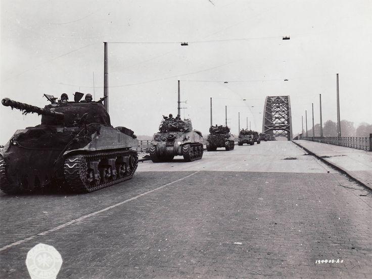 British tanks cross the Waal road bridge in Nijmegen, Sept. 21, 1944.