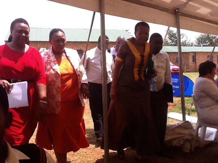 Minister of education together with the Telkom CEO entering the tent.