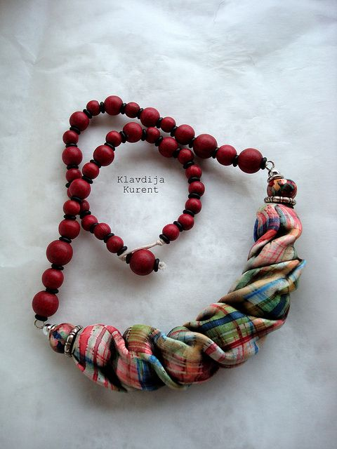 """Klavdija Kurent made plaid """"fabric"""" out of polymer clay and then draped it over beads to form this really unusual and unique necklace. Take a look..see the bead shapes under the plaid fabric. Wow."""