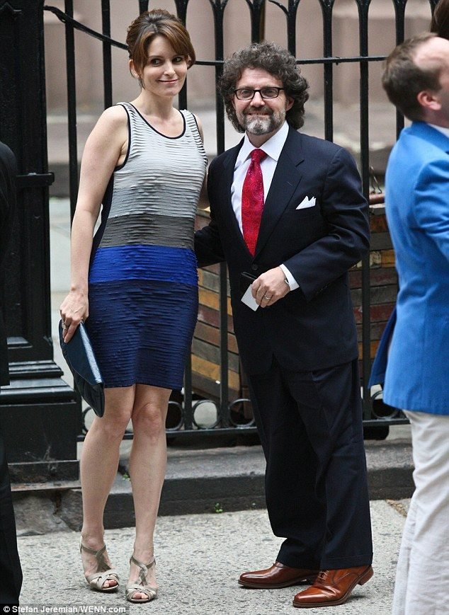 Funny girl: Tina Fey and her husband, Jeff Richmond, arrive at the wedding of her 30 Rock co-star Baldwin