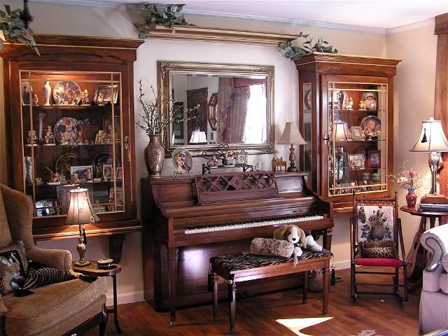 Luxury-living-room-in-british-colonial-style-with-piano-bench-sofa-chair-cabinets
