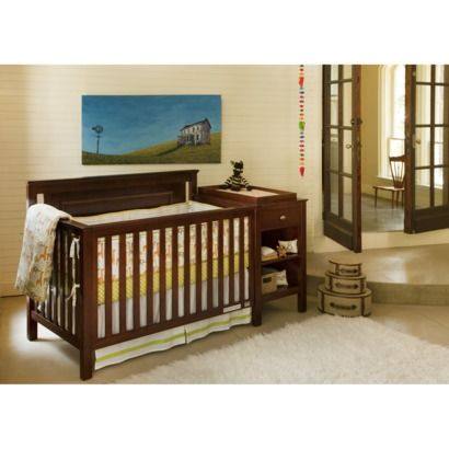 the Lolly & Me Cogan 4-in-1 Crib Changer Combo in  Mahogany for baby's room