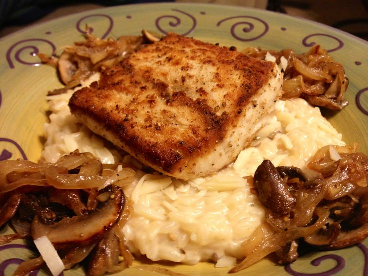 ... Mahi on top of truffle risotto with caramelized onion and mushrooms